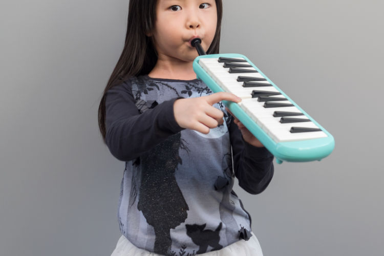 Girl playing melodica