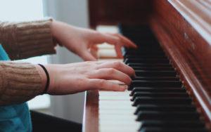 Girl playing piano keyboard