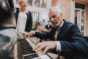 Older man playing piano