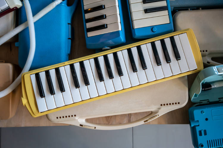 Several melodicas on a table